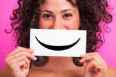 Young Woman with Smiley Emoticon on Fuchsia Background — Stockfoto