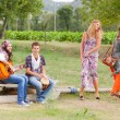 Hippie Group Playing Music and Dancing Outside — Stockfoto