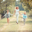 Beautiful Young Woman with Two Children Outside — Stock Photo