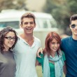 Group of Teenagers Outside with Old Minibus on Background — Stock Photo