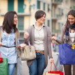 Stock Photo: Three Beautiful Young Women with Shopping Bags