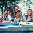 Group of Teenage Students at Park - Stock Photo