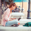 Beautiful Young Woman with Computer Outside - Stock Photo