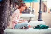 Beautiful Young Woman with Computer Outside — Stock Photo