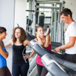 Royalty-Free Stock Photo: Attractive Man at Gym with Three Women