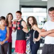 Royalty-Free Stock Photo: Group of at Gym with Instructor