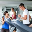 Running on Treadmill in the Gym — Stock Photo #13638543
