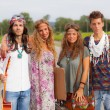 Hippie Group Walking on a Countryside Road — Stock Photo #13655519