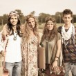 Hippie Group Walking on a Countryside Road — Stock Photo #13655708