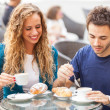 Young Couple Having a Traditional Italian Breakfast — Stock Photo