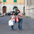 Couple of Women with Shopping Bags - 