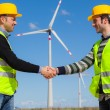 Engineers giving Handshake in a Wind Turbine Power Station — Stock Photo