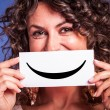 Young Woman with Smiley Emoticon — Stockfoto