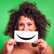 Young Woman with Smiley Emoticon on Green Background — Stockfoto