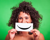 Young Woman with Smiley Emoticon on Green Background — Stok fotoğraf