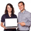 Business Team Holding a Computer with Blank Screen — Stock Photo
