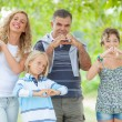 Royalty-Free Stock Photo: Happy Family with Heart Shaped Hands