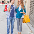 Young Couple with Shopping Bags — Stock Photo #13822403