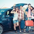 Four Friends Ready to Leave For Vacation — Stock Photo #13850860
