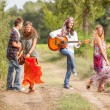 Hippie Group Playing Music and Dancing Outside — Стоковое фото