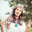 Hippie Portrait showing Peace Sign — Stock Photo #13977250