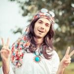 Hippie Portrait showing Peace Sign — Stock Photo