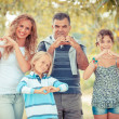 Happy Family with Heart Shaped Hands — Stock Photo #13984655