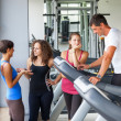 Attractive Man at Gym with Three Women - Zdjęcie stockowe