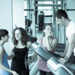 Attractive Man at Gym with Three Women - Стоковая фотография