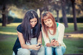 Two Young Women with Mobile Phone — Stock Photo