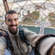 Young Man on the top of Tour Eiffel in Paris — Stock Photo