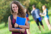Young Female Student at Park with Other Friends — Stock Photo