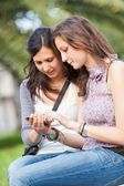 Two Beautiful Women Sending Messages with Mobile — Stock Photo