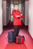 Bellboy with Luggages in the Hallway — Stock Photo