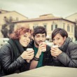 Stock Photo: Group of Friends with Hot Drink on Winter