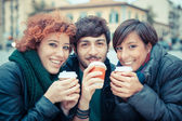 Group of Friends with Hot Drink on Winter — Stock Photo