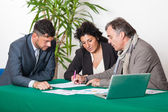 Mature Couple with Financial Consultant — Stock Photo