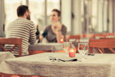 Romantic Young Couple at Restaurant — Stok fotoğraf