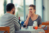 Boyfriend with Gift for Girlfriend at Restaurant — Stock Photo