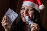 Bad Woman with Santa Hat destroying a Letter — Stock Photo