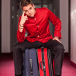 Stock Photo: Tired Bellboy with Luggages