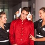 Chambermaids Helping Bellboy — Stock Photo