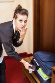 Chambermaid Stealing Money from Bag — Stock Photo