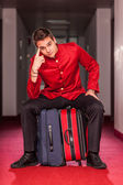 Tired Bellboy with Luggages — Stock Photo