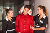 Chambermaids Helping Bellboy — Stock Photo