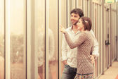 Romantic Young Couple Looking Out the Window — Stock Photo
