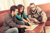 Group of Tourists Looking at Map in the Hotel — Stock Photo