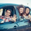 Boys and Girls in a Car Leaving for Vacation — Stock Photo