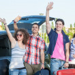 Four Friends Ready to Leave For Vacation — Stock Photo #15599891
