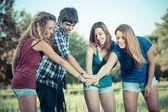 Group of Teenagers with Hands on Stack — Stock Photo